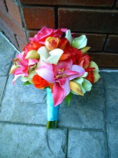 Silk Hot Pink Lilies and Roses, Silk Green Cymbidium Orchids,Real Touch Yellow Phaleanopsis orchids, Real Touch Ivory Calla Lilies, White Sik Roses, and Real Touch orange and yellow calla lilies Tropical Destination Wedding Bouquet