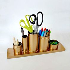 If you can scrounge up some soup cans, a shot glass, tea canisters, and a wood plank, you can keep your work space organized thanks to thisDIY pencil holder. The Anthropologie knockoff shines like the original but for a fraction of the price while keeping your work space neat and tidy. DIY desk accessories never looked this good.