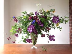 Clematis, bachelor's buttons, feverfew, sweet pea vines...