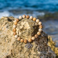 Lovely natural brown jasper beaded bracelet with Lotos charm. If you like simple natural bracelets you will definitely like this one. If fits with almost every bracelet so you can wear it every day.