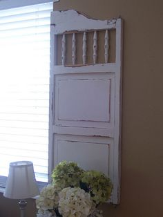 Salvaged parlor doors as shutters from Cottage Charm Creations (love her style, BTW)