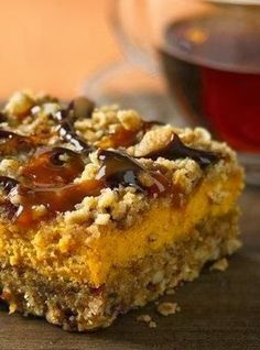 Pumpkin Streusel Cheesecake Bars - Chocolate and caramel drizzles add a new flavor punch to creamy pumpkin-oat bars.