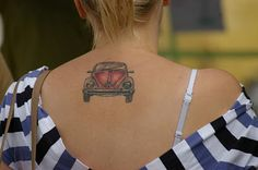 VW Beetle Tattoo... maybe I'd do a bug outline on my ribcage?