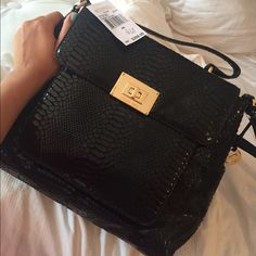 Michael Kors Genuine Leather Purse. Brand new. Never used. Still has tags on. Genuine Leather black tote. Long strap attached for cross body use. Perfect condition ❤️ MICHAEL Michael Kors Bags