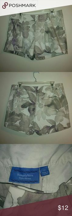 "White, lavender, and silver floral fancy shorts Cute floral shorts by Simply Vera Vera Wang. White with gray, lavender, and metallic silver floral pattern. Waist 36"", inseam 3.5"". Small mark on side near pocket, pictured. Simply Vera Vera Wang Shorts"