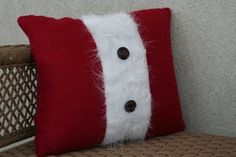 how cute are these!   I already have red pillows, all I'd have to do is make a white fur 'sleeve' and put buttons on it :)