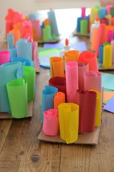 preschoolers make rolled paper sculptures ~ great art project for fine motor skills and problem solving #artsandcraftsforkidswithpaper,