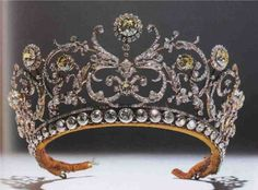 A lovely colourless and yellow diamond tiara, with multiple foliate scrolls and flower heads, nick-named the 'Daisy' tiara. Originally made, minus the base, for Princess Abamalek Lazarev by Bassett, for Boucheron, in 1907.