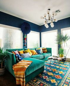 So much colour! :) I love this Bohemian interior design and this room is a beautiful part of a bohemian home decor theme. I love the bold colors mixed in with ecletic bohemian wall art and Bohemian decorative accents. A Gallery of Bohemian Bedroom Bohemian Living Rooms, Colourful Living Room, Living Spaces, Bohemian Room, Bohemian Homes, Colorful Couch, Eclectic Living Room, Bright Living Room Decor, Bright Decor