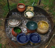Cooking with clay pottery over coals