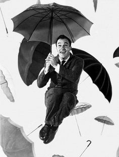 Gene Kelly - Singing in the Rain. My granddad always sang this to me and jumped round lampposts to make me smile as a kid.