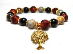 About the Bracelet Red and black with natural stones, this bohemian bracelet is just perfect for nature lovers with style. Bracelet Details: This tree of life bracelet is made with: ♥ 8mm Moss Agate ♥