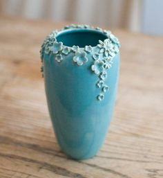 This ceramic vase is simple and pretty. The tiny flowers are detailed and repetitive which doesnt make the vase look so lonely.