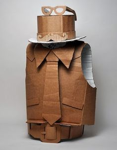 Yep, its true- I am married to a man who loves Halloween. While Im scrambling around putting last minute touches on Sayers costume Cardboard City, Cardboard Costume, Cardboard Sculpture, Cardboard Paper, Cardboard Crafts, Cardboard Mask, Cardboard Boxes, Recycled Costumes, Recycled Dress