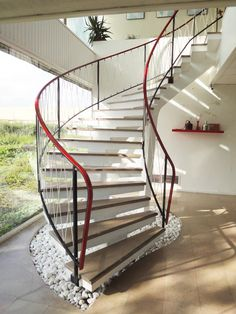 Image above: The monumental suspended stairway is a true work of art. It was created using reinforced concrete poured in a form, finished with polished marble steps and a brass railing. It is a marvel of engineering and design, seemingly floating, supported by three central columns.