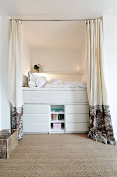 Built in bed with chest of drawers underneath. Such a good way to save space. Only wish the curtains had been shortened.