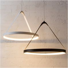 Modern by Dwell Magazine LED Pendant Light Black, $99.99I couldn't decide which color I liked best, so I'm showing them both. If you're after a contemporary vibe at home, these would be great over nightstands (in place of table lamps) or in a home office.