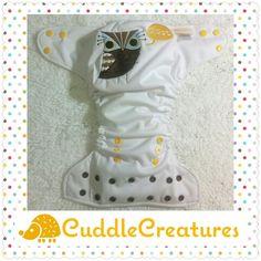 One size pocket cloth diaper, PUL exterior, microfleece interior. Owl Www.facebook.com/cuddlecreatures