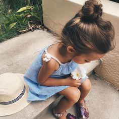 pretty top knot hairstyle for little girls   blue strip sun dress   kids style