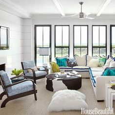 Light & bright.  Love the hint of painted trim on windows and animal print ottoman justaposed with the turquoise trim.