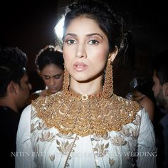 layered dress gold necklace with chandelier earrings | backstage at Shree Raj Mahal Indian Jewelry | India Couture Week 2014