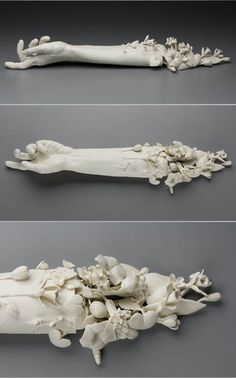 a stunning sculpture by Kate MacDowell. looks to me like the remains of a corpse, decaying and decomposed, yet flowers and new life beginning in its place.