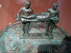 "Recovering a dead soldier (Etruscan 5th ct.). ""Italia Antiqua"" - Etruscan and Roman Art. Altes Museum, Berlin."