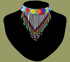 Traditional African Beaded Necklaces handmade by highly skilled Zulu Beadworkers from South Africa. African Jewelry including beaded bangles, bracelets and earrings. African Beads Necklace, Fringe Necklace, African Jewelry, Diy Necklace, Beaded Choker, Beaded Jewelry, Beaded Bracelets, African Crafts, African Accessories