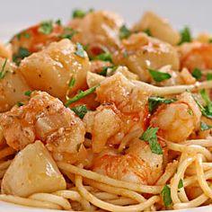 Croatian/Italian Seafood Pasta alla Buzara with briny, fresh rock shrimp and tender, sweet bay scallops.