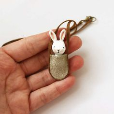 Bunny necklace - Paper clay miniature white rabbit in a bag - Wearable art