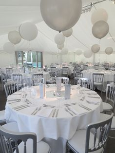 Handmade Shoes (UK) Ball. Giant helium balloons and horseshoe centre-pieces looked amazing.