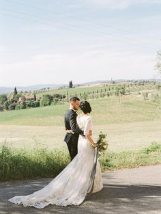 Bride and groom walking in countryside | Photography: Coco Tran