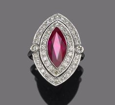 A ruby and diamond ring  centering a marquise-shaped ruby, estimated ruby weight: 2.50 carats; estimated total diamond weight: 1.00 carat; mounted in eighteen karat white gold;
