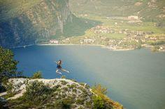 Jumping in the air. - Jumping on the peak, near Pregasina, on Lake Garda, Trentino, ITaly.