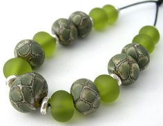 Examples of scale beads - Olive, then EDP scales and lastly, on Ivory