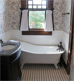 Add wallpaper to your bathroom to complete your Victorian bathroom.