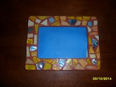 Terra Cotta, yellow and turquoise mosaic frame.