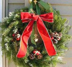 Red bow and evergreen boughs make for an elegant, classic Christmas Wreath.