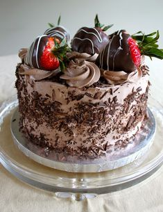 Cafe Coco: Dark Chocolate Cake with Dark Chocolate Mousse Filling and Chocolate Italian Meringue Buttercream Chocolate Shavings and Chocolate Covered Strawberries