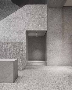 david chipperfield valentino new york flagship. a double-height space houses a monolithic staircase made of palladiana stone.