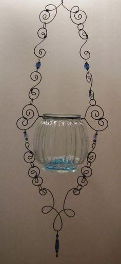 Hanging Wire Wrapped Glass Candle Holder.