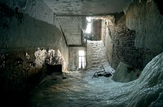 Abandoned building in Norilsk, Siberia. House filled with ice, following break in a water pipe. (photo Elena Chernyshova/National Geographic)