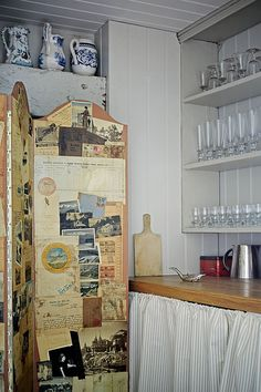 A pantry, with storage for glassware, is tucked behind the sitting-room bookshelves. The the bedroom gallery above is accessed by a ladder, where a Chinese screen is used to create a dressing area