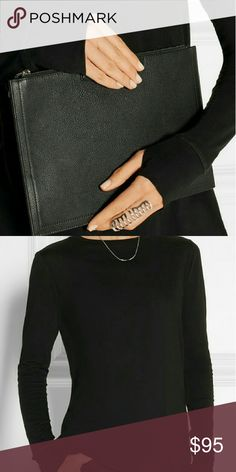 NWT HELMUT LANG BLACK THUMBHOLE JERSEY TOP SZ XS CURRENT NWT HELMUT LANG COTTON-CASHMERE BLEND TOP WITH THUMBHOLES SZ XS. SLIGHT LOOSE FIT. PERFECT LAYERING PIECE.   NOTE THAT ITEMS MIGHT BE STAMPED ON INSIDE TO PREVENT STORE RETURN. Helmut Lang Tops Tees - Long Sleeve