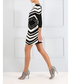 A monochrome colour palette is key for autumn/winter, so add this black and white striped bodycon dress to your collection. Featuring long sleeves, a figure-flattering zig-zag print and beaded embellishments, wear this bodycon dress to your next high-end affair.