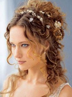 #Victorian hair style with flowers and loose flowing curls. #hairstyles
