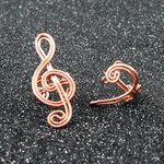Treble and bass clef ear cuffs