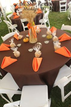Rose Infused Tangerine Tablescape Adorned With Silver Accents And Glimmering Votives