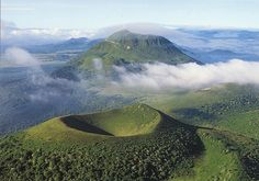 Le Puy de Dôme (French volcano) - This is one of a chain of about 8 dormant volcanoes in France. They are now used for cycling, hang gliding and other outdoor activities. It includes the site of a Roman temple to the God Mercury. It looks like an amazing place to visit!