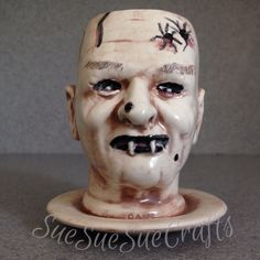 Gift for men. Little man Vampire doll head planter. Here you go, a head planter altered, to be a vampire, made from a doll head mold. This